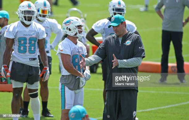 Miami Dolphins head coach Adam Gase talks with Dolphins wide receiver Danny Amendola during the Miami Dolphins Organized Team Activities at the...