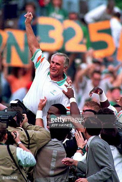 Miami Dolphins head coach Don Shula gets carried off the field by his players 14 November 1993 after beating the Philadelphia Eagles 1914 The win was...