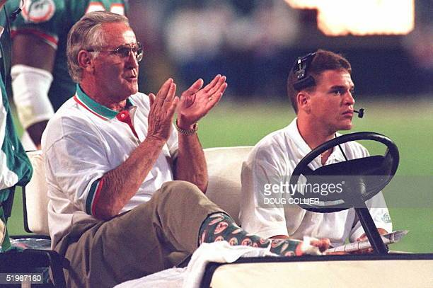 Miami Dolphins head coach Don Shula reacts to game action from his golf cart as his team takes on the Kansas City chiefs 12 December in Miami Shula...
