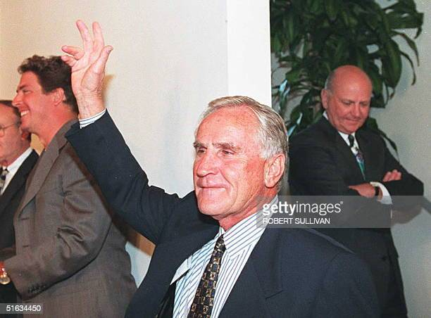 Miami Dolphins head coach Don Shula team owner Wayne Huizenga and quarterback Dan Marino arrive at a press conference to announce Shula's retirement...