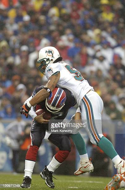 Miami Dolphins linebacker Channing Crowder makes a sack on Buffalo Bills quarterback JP Losman at Ralph Wilson Stadium in Orchard Park, New York on...