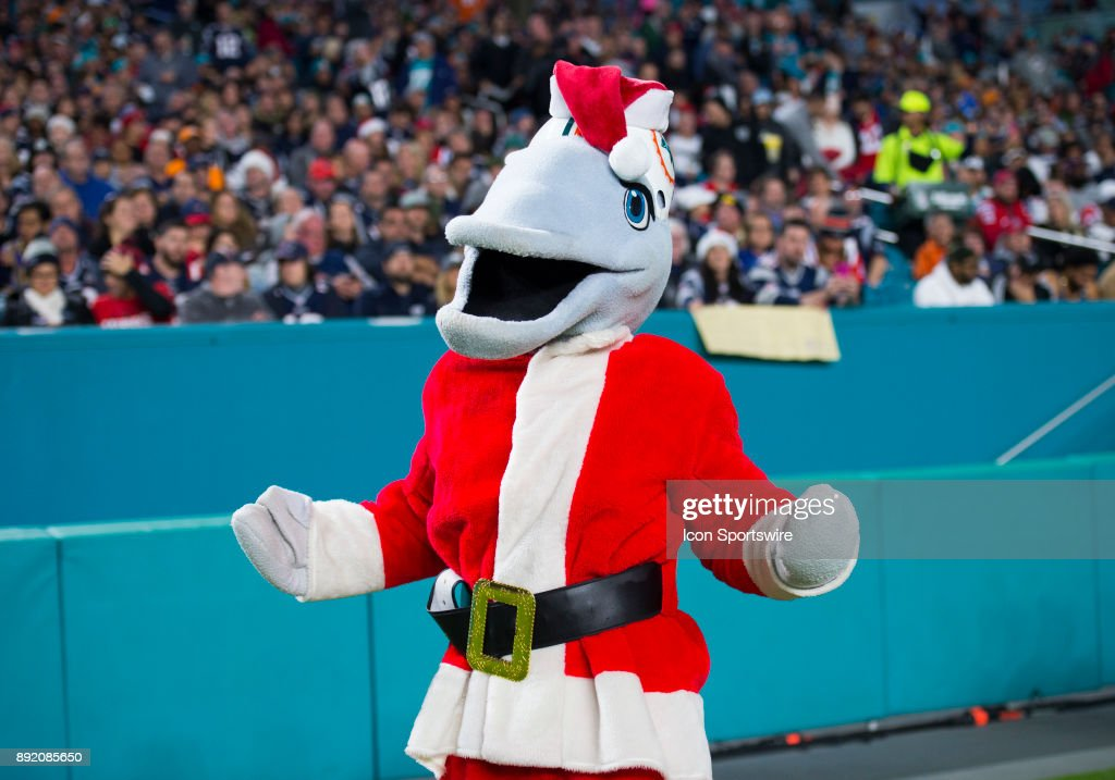 8da2cbc6de5002 Miami Dolphins mascot T.D. wears a Santa costume on the sidelines ...