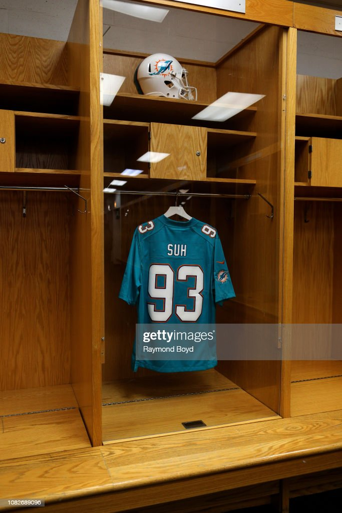 A Miami Dolphins Ndamukong Suh football jersey hangs in the visiting  oUfFQdWe