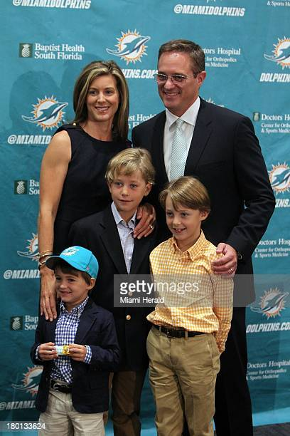 Miami Dolphins new CEO Tom Garfinkel, top right, poses for portrait with wife Allison and sons Harrison center, Jackson 8, right, and Miller at...