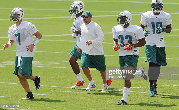 Miami Dolphins' offensive coordinator Brian Daboll leads the Dolphins' offense onto the field during a training camp workout on Saturday, July 30 at...