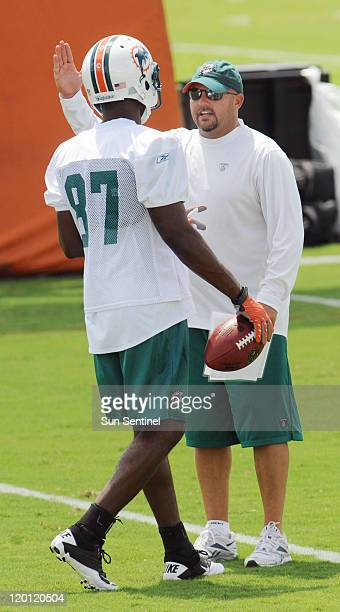 Miami Dolphins offensive coordinator Brian Daboll works with wide receiver Brooks Foster during a training camp workout on Saturday, July 30 at the...