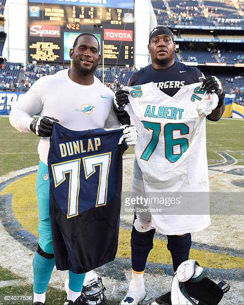 Miami Dolphins Offensive Tackle Branden Albert and San Diego Chargers Offensive Tackle King Dunlap exchange jerseys after the NFL football game...