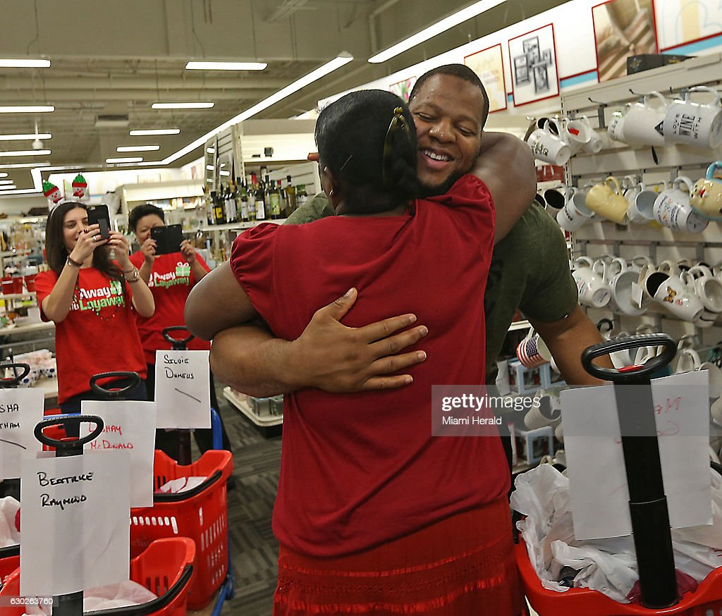 The Raiders Can And Should Sign Ndamukong Suh: Miami Dolphins Player Ndamukong Suh Gets A Hug From Marva