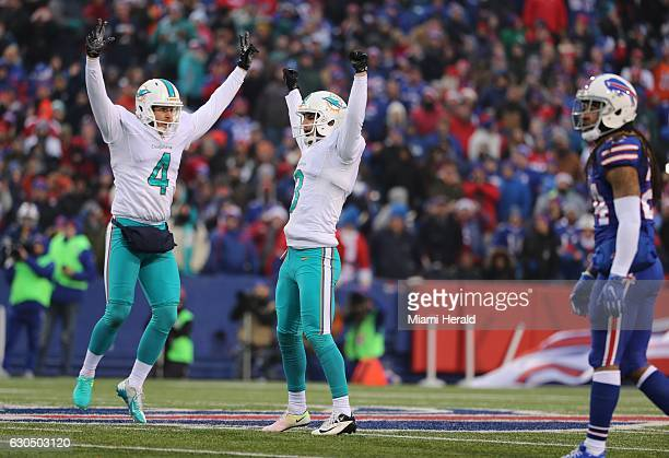 Miami Dolphins punter Matt Darr and kicker Andrew Franks celebrate after the 27yard gamewinning goal in overtime against the Buffalo Bills at New Era...