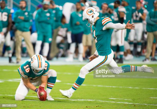 Miami Dolphins Punter Matt Haack holds the ball as Miami Dolphins Kicker Cody Parkey kicks the ball for a field goal a during the NFL football game...