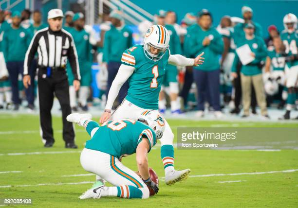 Miami Dolphins Punter Matt Haack holds the ball as Miami Dolphins Kicker Cody Parkey kicks a field goal during the NFL football game between the New...