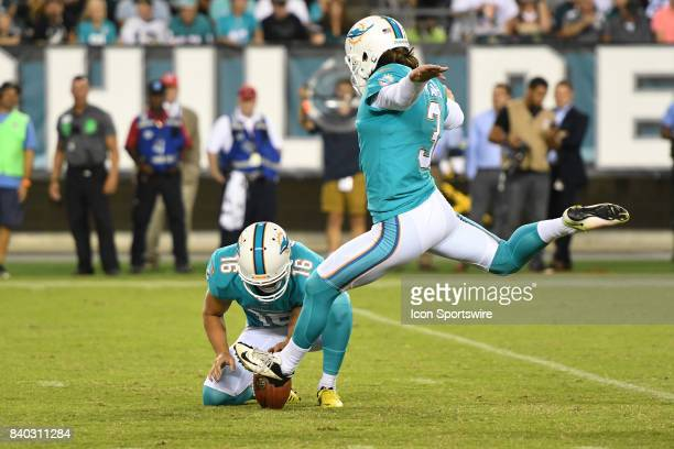 Miami Dolphins punter Matt Haack holds the ball for Miami Dolphins kicker Andrew Franks during a NFL preseason game between the Miami Dolphins and...