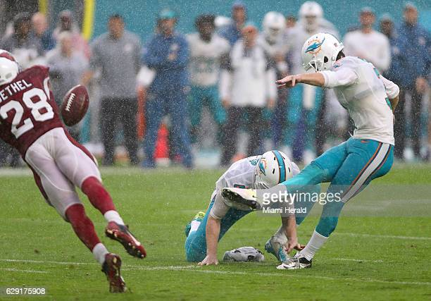 Miami Dolphins punter/kicker Andrew Franks kicks the winning field goal in the fourth quarter of an NFL football game against Arizona Cardinals at...