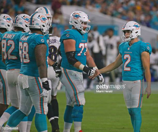 Miami Dolphins punter/kicker Matt Haack is congratulated by teammates after making a field goal during the second quarter against the Baltimore...