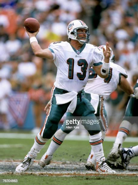 Miami Dolphins quarterback Dan Marino , inducted into the Pro Football Hall of Fame class of 2005, fires a pass during the AFC Wild Card Playoff, a...