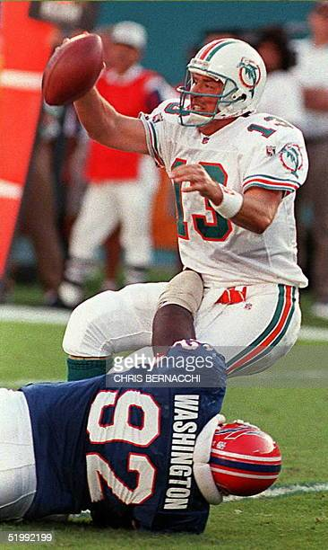 Miami Dolphins quarterback Dan Marino is sacked by Buffalo Bills nose tackle Ted Washington during the second quarter at Joe Robbie Stadium in Miami...