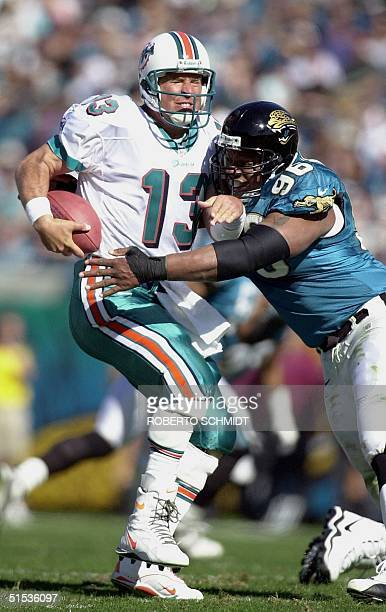 Miami Dolphins quarterback Dan Marino is sacked by Gary Walker of the Jacksonville Jaguars during the first half 15 January 2000 in their AFC...