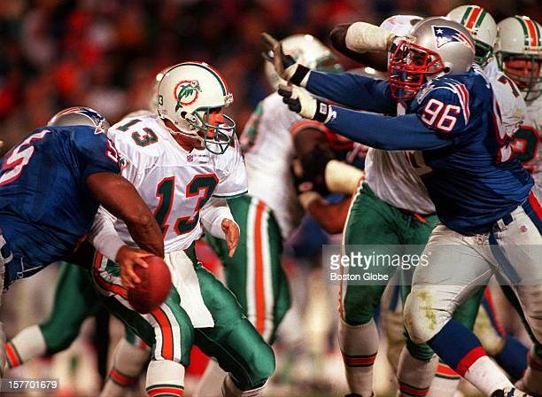 Miami Dolphins quarterback Dan Marino prepares to be hammered by New England Patriots players Wille McGinest and Mike Jones Marino fumbled the ball...
