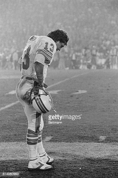 Miami Dolphins quarterback Dan Marino stands with his head down on the sidelines as his team goes down to defeat against the San Francisco 49ers in...