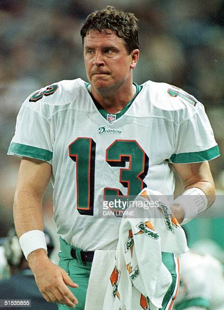 Miami Dolphins quarterback Dan Marino takes a sideline breather during his first half of his AFC playoff game against the Seattle Seahawks in Seattle...