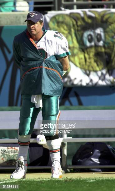 Miami Dolphins' quarterback Dan Marino watches from the sidelines after being pulled from the game against the Jacksonville Jaguars 15 January 2000...
