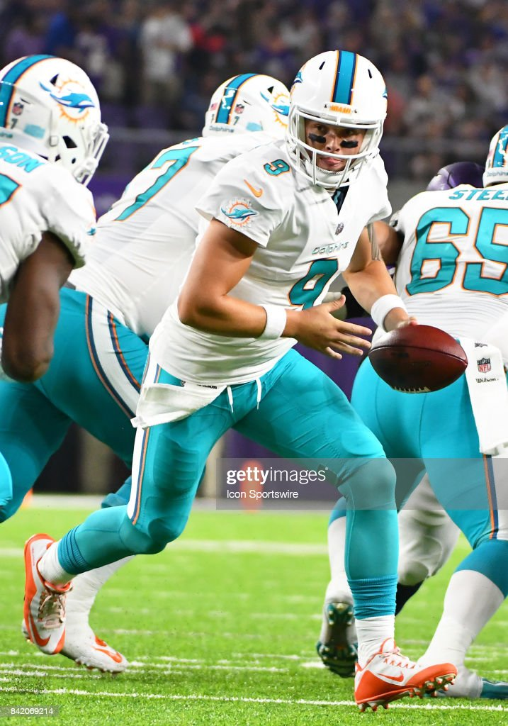 Miami Dolphins quarterback David Fales (9) looks to hand off during a NFL preseason game between the Minnesota Vikings and Miami Dolphins on August 31, 2017 at U.S. Bank Stadium in Minneapolis, MN. The Dolphins defeated the Vikings 30-9.