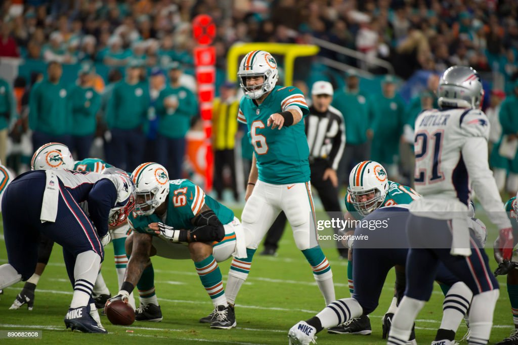 Miami Dolphins Quarterback Jay Cutler (6) gestures at the line of srimmage during the NFL football game between the New England Patriots and the Miami Dolphins on December 11, 2017, at the Hard Rock Stadium in Miami Gardens, FL.
