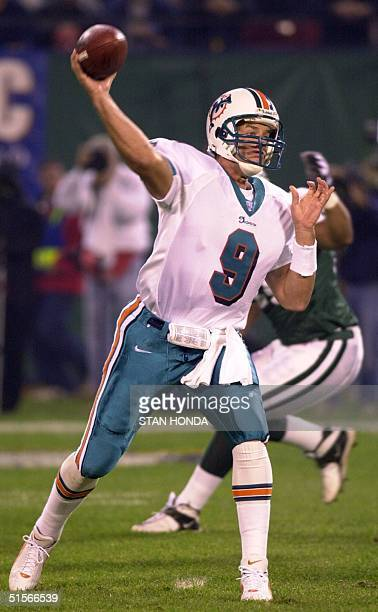 Miami Dolphins' quarterback Jay Fiedler throws a pass in the first quarter of the game against the New York Jets 23 October at Giants Stadium in East...