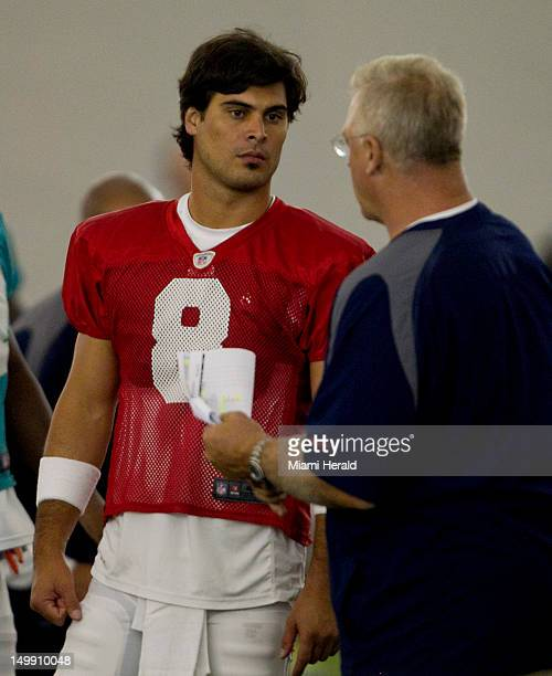 Miami Dolphins quarterback Matt Moore, left, listens to offensive coordinator Mike Sherman during practice at Dolphins training camp at NSU in Davie,...