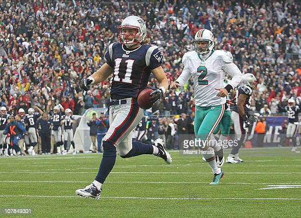 Miami Dolphins quarterback punter Brandon Fields chases New England Patriots Julian Edelman, who returned a punt 94 yards for a second-quarter...
