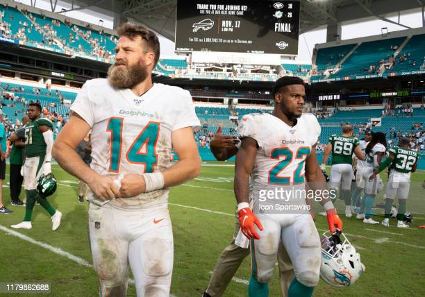 Miami Dolphins Quarterback Ryan Fitzpatrick and Miami Dolphins Running Back Mark Walton walk off the field after the NFL game between the New York...