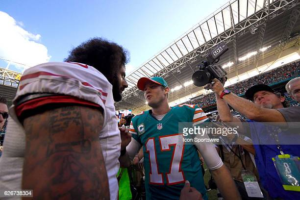 Miami Dolphins quarterback Ryan Tannehill and San Francisco 49ers quarterback Colin Kaepernick shake hands after the NFL football game between the...