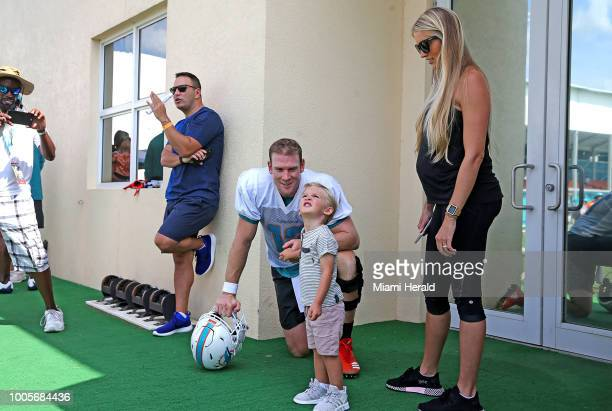 Miami Dolphins quarterback Ryan Tannehill with his son Steel and his wife Lauren after the first day of training camp at the Miami Dolphins training...