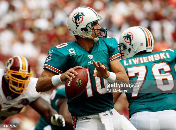 Miami Dolphins quarterback Trent Green looks for a receiver against the Washington Redskins in second quarter action at FedEx Field September 9, 2007...
