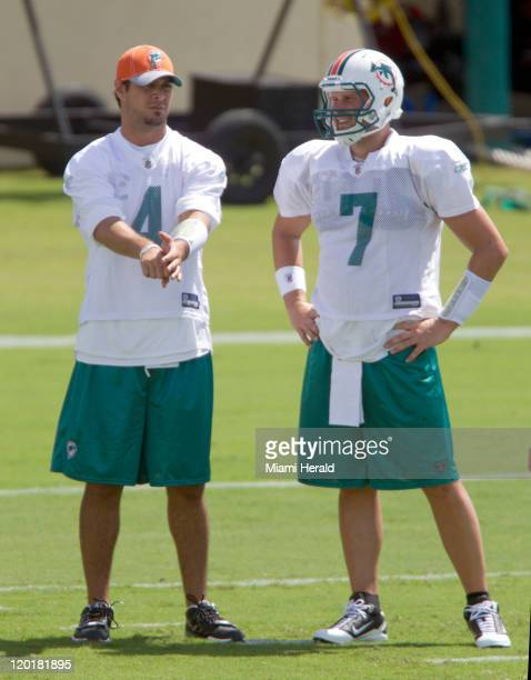 Miami Dolphins quarterbacks Matt Moore and Chad Henne (70 chat during the team's practice in Davie, Florida, Sunday, July 31, 2011.