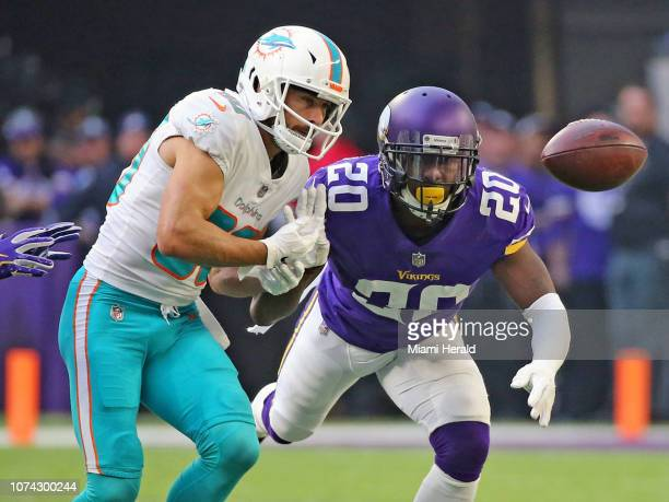 Miami Dolphins receiver Danny Amendola misses a pass in the first quarter as he is defended by Minnesota Vikings Mackensie Alexander on Sunday Dec 16...
