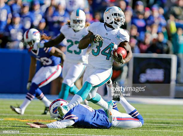 Miami Dolphins running back Damien Williams leaps for yardage during the first quarter on Sunday Nov 8 at Ralph Wilson Stadium in Orchard Park NY