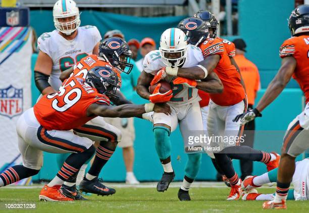 Miami Dolphins running back Frank Gore runs through the Chicago Bears defense in overtime on October 14 at Hard Rock Stadium in Miami Gardens Fla
