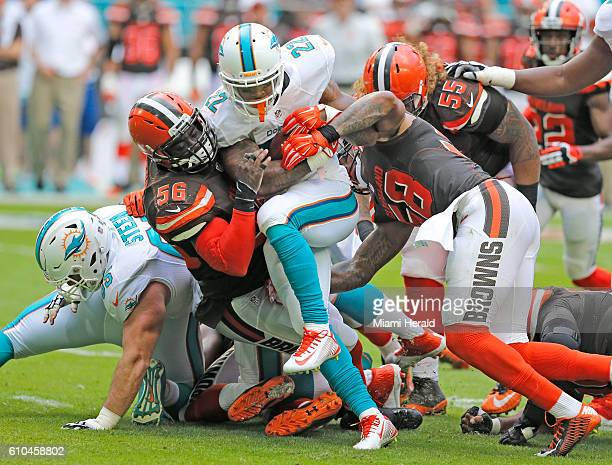 Miami Dolphins running back Isaiah Pead is taken down by Cleveland Browns inside linebacker Demario Davis in the second quarter at refurbished Hard...