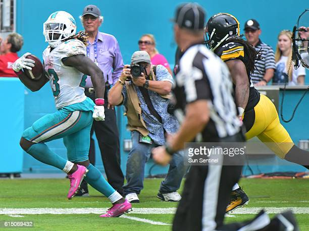 Miami Dolphins running back Jay Ajayi scores a touchdown to seal the win for the Dolphins over the Pittsburgh Steelers on Sunday Oct 16 2016 at Hard...