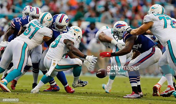 Miami Dolphins running back Jonas Gray fumbles the ball recovered by the Dolphins tackle Jason Fox during the second quarter on Sunday Sept 27 at Sun...