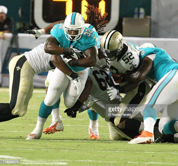 Miami Dolphins running back Jonas Gray runs for a first down in the second quarter of a preseason game against the New Orleans Saints at Sun Life...