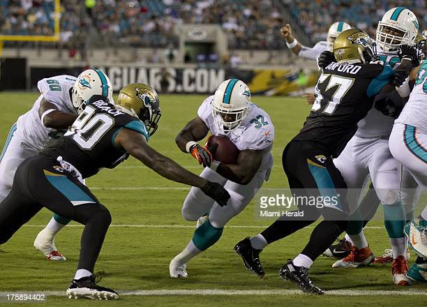 Miami Dolphins running back Jonas Gray scores a oneyard touchdown in the second quarter of preseason action against the Jacksonville Jaguars at...