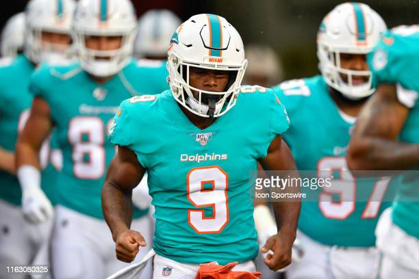 Miami Dolphins running back Mark Walton enters the field prior to the first half of an NFL preseason game between the Miami Dolphins and the Tampa...