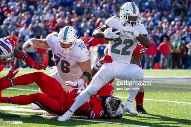 Miami Dolphins Running Back Mark Walton runs with the ball breaking tackles during the second half of the National Football League game between the...