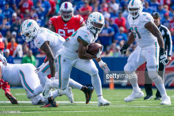 Miami Dolphins Running Back Mark Walton runs with the ball during the first half of the National Football League game between the Miami Dolphins and...