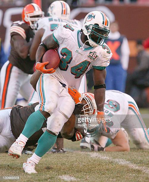 Miami Dolphins running back Ricky Williams scrambles for yards during the game against the Cleveland Browns at Cleveland Browns Stadium in Cleveland...