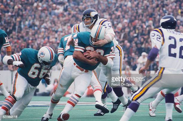 Miami Dolphins' runningback Larry Csonka runs with the ball as a Minnesota Vikings player attempts to tackle during Super Bowl VIII at Rice Stadium...