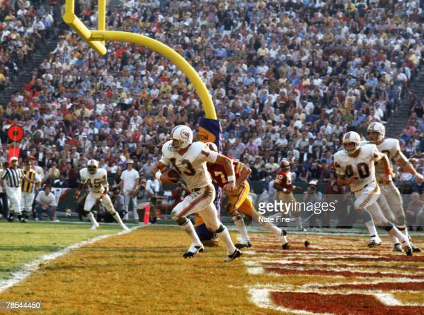 Miami Dolphins safety Jake Scott intercepts a fourth quarter pass in his end zone and returns it 55 yards against the Washington Redskins in Super...