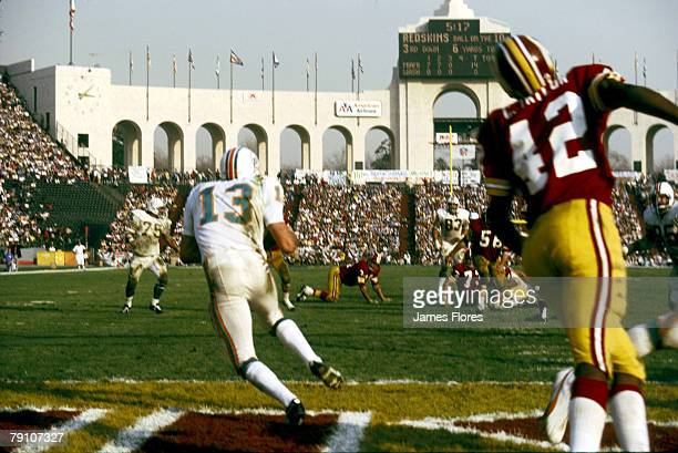 Miami Dolphins safety Jake Scott intercepts a pass in the intended for Redskins Charley Taylor in a 147 win over the Washington Redskins in Super...